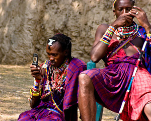 Maasai warriors on their cell phones, in rural Kenya. Are they more connected than your small business?